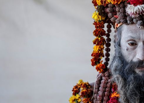 A Naga Sadhu or Hindu holy man waits for devotees inside his camp during Kumbh Mela or the Pitcher Festival, in Prayagraj, previously known as Allahabad, India. Photograph: Danish Siddiqui/Reuters