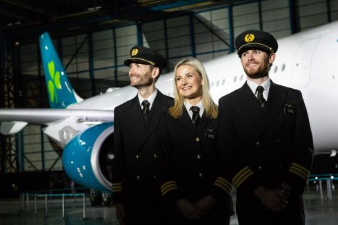 At the Aer Lingus rebrand before an Airbus A330 freshly painted in the new aircraft livery was from left first officer Niall McCauley, first officer Laura Bennett; and first officer Paul Deegan. Photograph: Naoise Culhane