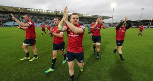Munster's Peter O'Mahony, JJ Hanrahan, Rory Scannell, Billy Holland and Chris Cloete applaud the travelling support after the draw away to Exeter at Sandy Park. Photograph:  Billy Stickland/Inpho