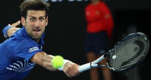 Serbia's Novak Djokovic in action  against France's Jo-Wilfried Tsonga in the second round of the Australian Open at Melbourne Park on Thursday. Photograph: Lucy Nicholson/Reuters