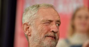 Labour  leader Jeremy Corbyn winks to a colleague during  a political rally  in Hastings, southeast England, on Thursday. Photograph: Ben Stansall/AFP/Getty Images