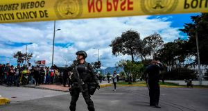 Security forces stand guard at the site of an explosion at a police academy in Bogotá  on Friday. Photograph: Juan Barreto/AFP/Getty Images
