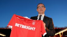 Martin O'Neill, the new Nottingham Forest manager,  poses with a shirt after a press conference at the City Ground, Nottingham. Photograph: Mike Egerton/PA