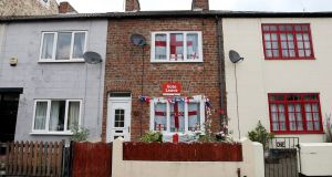 "St George flags in the windows and a ""Vote Leave"" poster on a house in Redcar, northeast England, in 2016. Photograph: Scott Heppell/AFP/Getty Images"