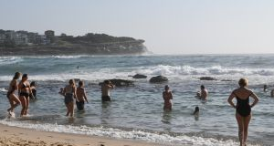 Beachgoers cool off at Bronte Beach in Sydney as heatwave conditions swept across the state last week. Photograph: Joel Carrett/EPA