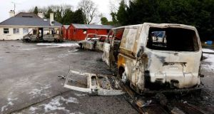Burned-out vans and cars in the yard of the house in Strokestown in December. Photograph: Brian Farrell