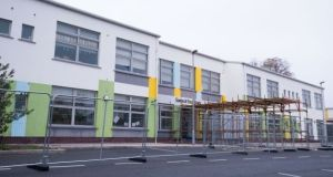 Protective fencing erected outside Gaelscoil Eiscir Riada, Glebe, Lucan, Co Dublin. It is one of five schools which will undergo detailed structural assessments from this weekend. Photograph: Tom Honan