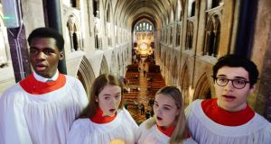 KING'S CHOIR:Daniel Ohoka, Ella Giles, Sofia-Rose Deeleman and Andreï Zündel, members of The King's Hospital school chapel choir sing from the nave of St Patrick's Cathedral as pupils, staff and families arrive for a Service of Celebration to mark the 350th anniversary of the school. Photograph: Alan Betson/The Irish Times