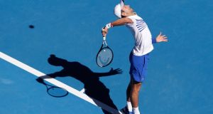 Novak Djokovic serves during his third-round match against Denis Shapovalov at the Australian Open in Melbourne. Photograph: Mast Irham/EPA
