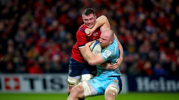 Munster's Peter O'Mahony tackles h Matt Kvesic of Exeter during the Heineken Champions Cup match at Thomond Park. Photograph: Oisín Keniry/Inpho