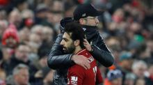 Liverpool's Mohamed Salah is embraced by manager Jurgen Klopp after being substituted during the win over Crystal Palace. Photograph: Reuters