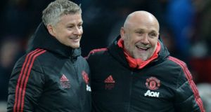 Manchester United interim manager Ole Gunnar Solskjaer celebrates after the win over Brighton with his assistant manager Mike Phelan. Photograph: Reuters