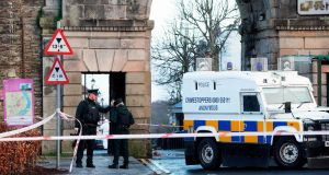Poice Officers and police forensic officers work at the scene in the aftermath of a suspected car bomb explosion in Derry. Photograph:  Paul Faith/AFP/Getty Images