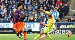 Manchester City's Leroy Sané scores his side's third goal  during the Premier League match against Huddersfield at the John Smith's Stadium. Photograph:  Martin Rickett/PA Wire