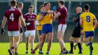 Roscommon's Enda Smith and Tom Flynn of Galway during the FBD League final. Photograph: Tommy Dickson/Inpho