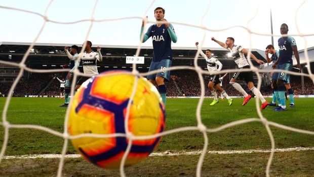 Tottenham's Fernano Llorente scores an own goal to give Fulham the lead at Craven Cottage. Photograph: Clive Rose/Getty