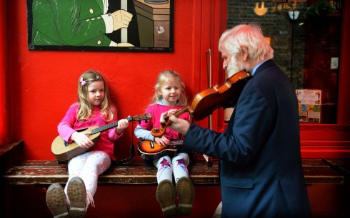 TRADFEST:John Sheahan of The Dubliners joined by young music fans Kate Mulcahy and Lily Bourke, both from Donabate, ahead of the 2019 TradFest, which starts on January 23rd in Dublin. Photograph: Dara Mac Donaill/The Irish Times