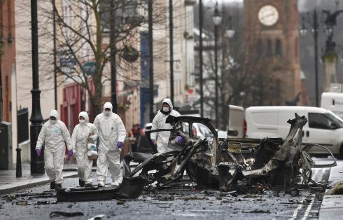 DERRY BOMB: Forensics officers inspect the remains of the van used as a car bomb on an attack outside Derry courthouse. Dissident republicans are suspected to have carried out the attack. Photograph: Charles McQuillan/Getty Images