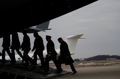 HONOUR GUARD: US president Donald Trump follows military leaders, secretary of state Mike Pompeo and a military honour guard into the back of an Air Force transport plane in Dover, Delaware. They were retrieving the remains of Scott Wirtz, a civilian employee of the US Defense Intelligence Agency killed along with three members of the US military during a recent attack in Syria. Photograph: Carlos Barria/Reuters