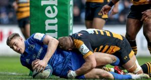Garry Ringrose scores a try for Leinster in their Heineken Champions Cup Round 6 match against Wasps at Ricoh Arena in Coventry on Sunday. Photograph: Dan Sheridan/Inpho