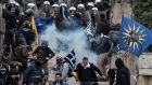 Protesters clash with riot police in Athens on Sunday during a demonstration against the agreement with Skopje to rename neighbouring country Macedonia as the Republic of North Macedonia. Photograph: Louisa Gouliamaki/AFP/Getty Images