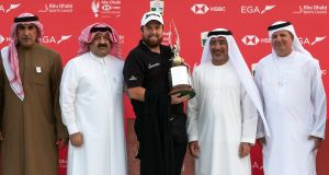 Shane Lowry with the trophy after winning the 2019 Abu Dhabi HSBC Golf Championship in Abu Dhabi. Photograph: Neville Hopwood/EPA