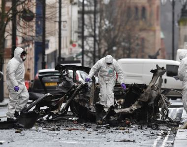 Forensic officers on Sunday inspect the remains of the van used at the weekend as a car bomb on an attack outside the courthouse in Derry. Photograph: Charles McQuillan/Getty Images