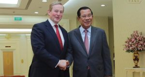 Former taoiseach Enda Kenny pictured with the long-serving Cambodian prime minister Hun Sen. Photograph: University of Cambodia/Facebook