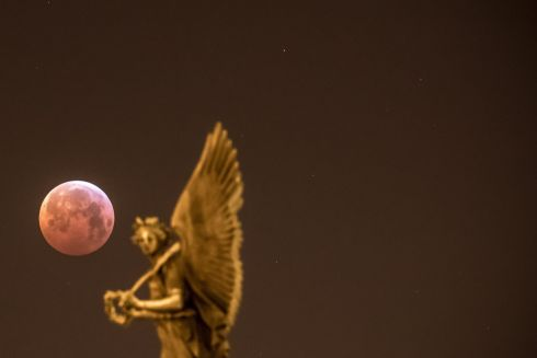 The so-called 'Super Blood Wolf Moon' is seen over city centre in Prague, Czech Republic. Photograph: Martin Divisek/EPA
