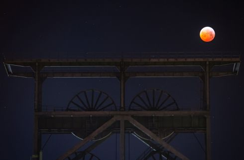 A Super Blood Moon is above a mineshaft in Dortmund, western Germany. Photograph: Bernd Thissen/AFP