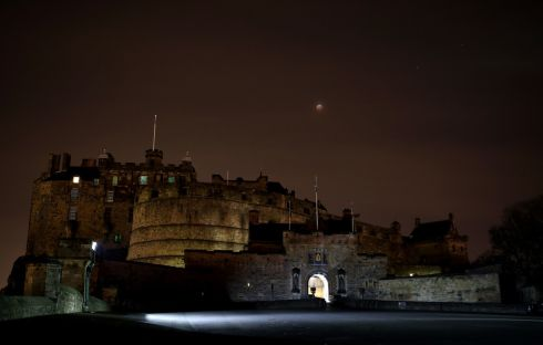 A super blood wolf moon over Edinburgh Castle during a lunar eclipse. Photograph: Jane Barlow/PA Wire