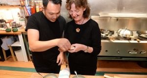 Kwanghi Chan, chef and restaurant owner, teaching Marie-Claire Digby how to make Pot Sticker dumplings. Photograph: Dara Mac Dónaill