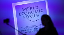 A visitor taking a selfie ahead of the World Economic Forum  in Davos. Photograph: Simon Dawson/Bloomberg