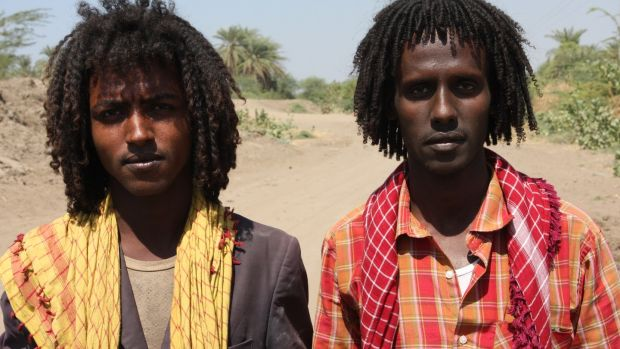 Young Afar men without the weapons often carried by many. Photograph: James Jeffrey