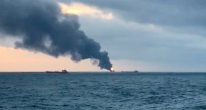 Smoke rises from a fire at a ship in the Kerch Strait near Crimea. Photograph: Reuters