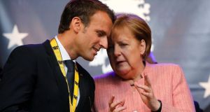 French president Emmanuel Macron and German chancellor Angela Merkel: Critics say the treaty lacks ambition and does not address the euro zone, migrants or social and environmental policy. Photograph: Wolfgang Rattay