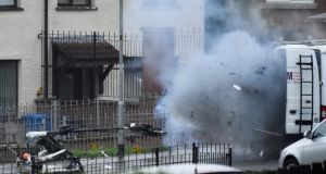 Debris from a suspected vehicle as a controlled explosion takes place at the scene of a security alert in Derry. Photograph: Clodagh Kilcoyne/Reuters