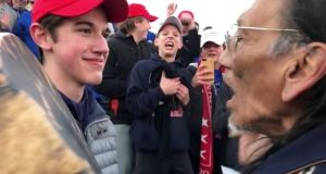 A still from the original video depicting Nick Sandmann (L) and Nathan Phillips. Photograph: Kaya Taitano/Social Media/via Reuters