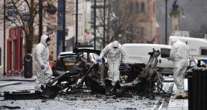 Forensic officers inspect the remains of the van used as a car bomb on an attack outside Derry Court House on Saturday. Photograph:  Charles McQuillan/Getty Images