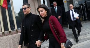 Cristiano Ronaldo leaves with his girlfriend Georgina Rodriguez after appearing in court on a trial for tax fraud in Madrid. Photo: Susana Vera/Reuters
