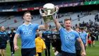 Dublin's Brian Fenton and Ciarán Kilkenny celebrate with the Allianz Football League Division One  trophy in 2018. Photograph: Inpho/Bryan Keane