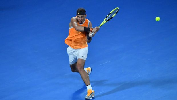 Spael Nadal plays a backhand return to Frances Tiafoe during their men's singles quarter-final match at the Australian Open in Melbourne. Photo: Paul Crock/Getty Images