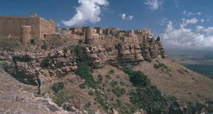 Fortified Kawkaban town in  Al-Mahwit province in Yemen: the ancient site was destroyed entirely.   Photograph:  DEA/C Dani/I Jeske/De Agostini/Getty