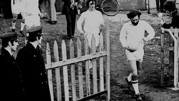 George Best runs out onto the pitch at Flower Lodge for his Cork Celtic debut against Drogheda in 1975. Photo: Irish Examiner archive