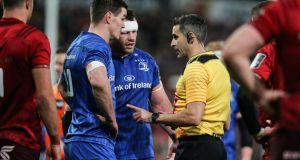 Leinster's Johnny Sexton and Cian Healy speak to referee Frank Murphy in Thomond park. Photograph:  Gary Carr/Inpho