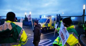 Ambulance  staff  at the ambulance  facility on Davitt Road, Dublin, during their  work stoppage on Tuesday  in their dispute over trade union representation rights. Photograph Nick Bradshaw