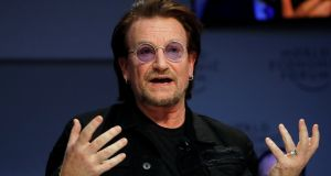 Bono, U2 singer and co-founder of the One campaign, speaks during the World Economic Forum (WEF) annual meeting in Davos, Switzerland. Photograph:   Arnd Wiegmann/Reuters