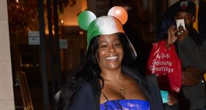 American rapper Azealia Banks leaving her hotel wearing helmet sprayed in green, white and orange on the way to her Dublin concert at The Academy. Photograph: Cathal Burke/vipireland.com