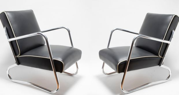 A pair of art deco chrome and leather armchairs