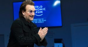 "Capitalism is ""a wild beast"": U2 frontman Bono takes centre stage in a panel session at the World Economic Forum in Davos. Photograph: Laurent Gillieron/Keystone via AP"